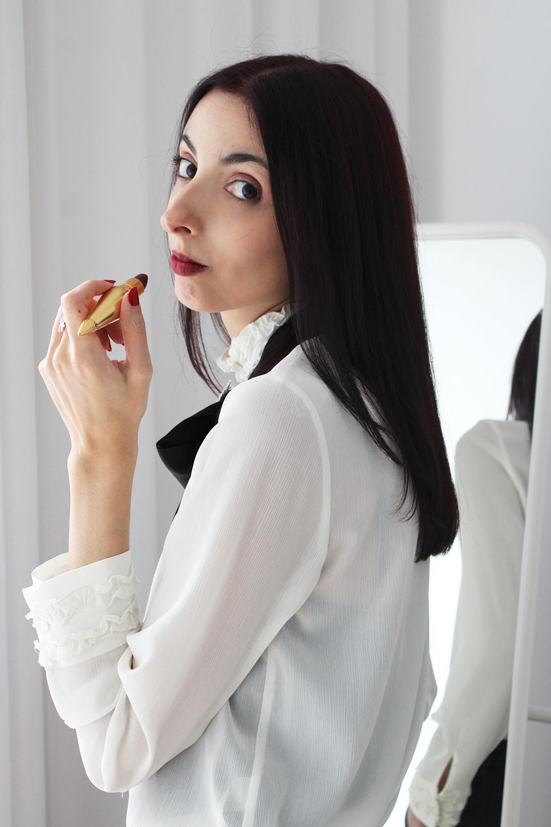 Allegra Caro testing Louboutin Beauty